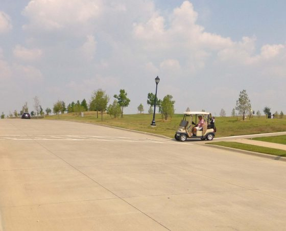 Golf Cart Crossing #3: on Anthem Drive (turns into Frisco Lakes Drive), on the north side of the clubhouse.  Golf carts and pedestrians using this crossing have no stop sign.
